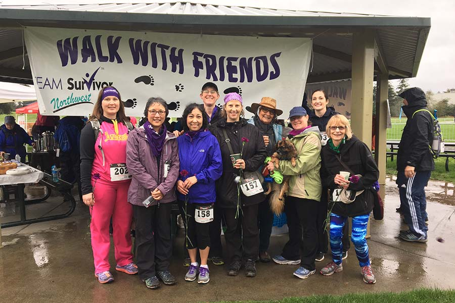 walk with friends attendees posing in a group