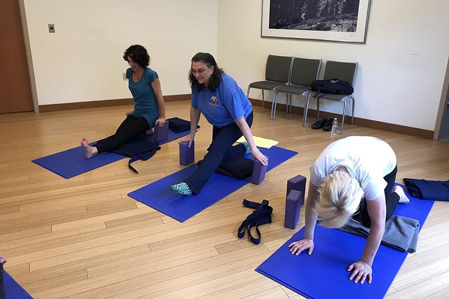 women doing yoga on the floor