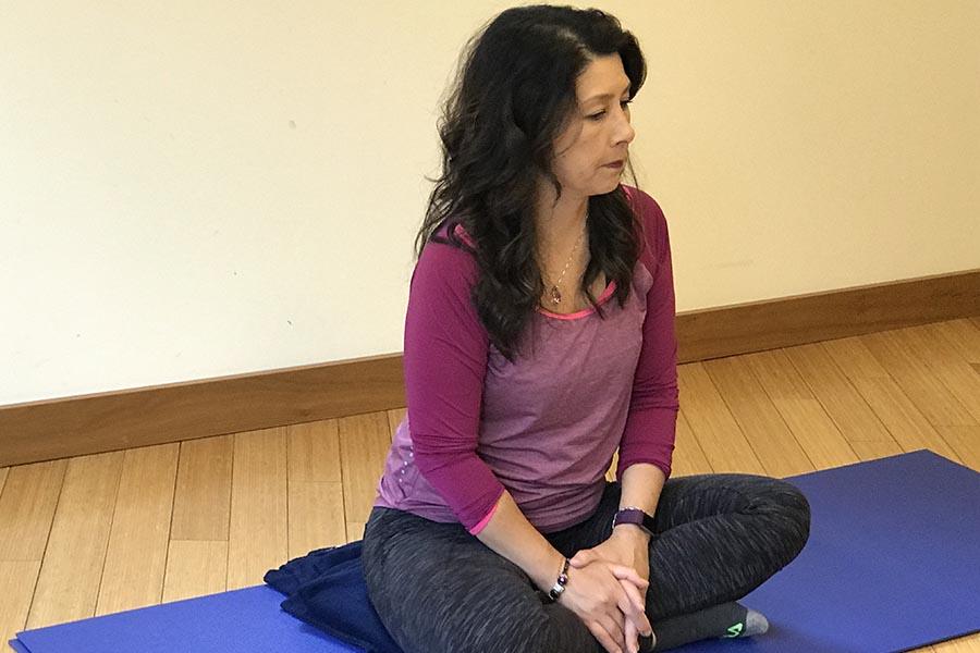 woman siitting on yoga mat